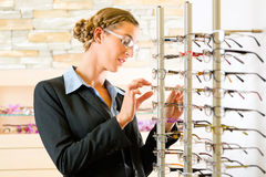 Young couple at optician with glasses Stock Image