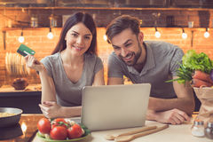 Young couple ordering food online Royalty Free Stock Image