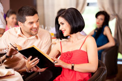 Young couple ordering food restaurant table Stock Photos