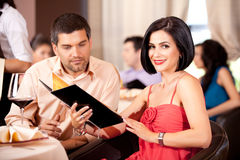 Young couple ordering food restaurant table Royalty Free Stock Photo