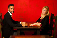 Young couple ordeting food in restaurant reading menu Stock Photos