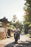 Young couple out on a motorbike ride. Royalty Free Stock Photo