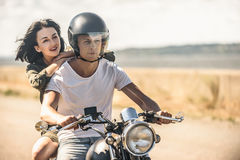 Young couple out for ride on motorbike Stock Image