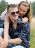 Young couple outdoor. Young couple having fun on nature background Royalty Free Stock Photo