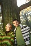 Young couple outdoor at autumn. Young love couple outdoor in park at autumn, smiling Stock Image