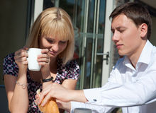 Young couple in outdoor cafe Royalty Free Stock Photo