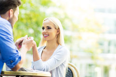 Young couple at outdoor cafe Royalty Free Stock Photography