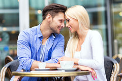 Young couple at outdoor cafe Stock Image