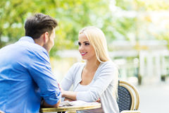 Young couple at outdoor cafe Royalty Free Stock Images