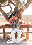 Young couple outdoor portrait. Beautiful pretty girl kissing handsome boy. Sensual photo Stock Photos
