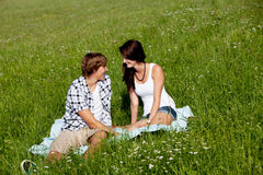 Young couple outdoor in summer on blanket Stock Image