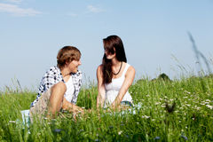 Young couple outdoor in summer on blanket Stock Images