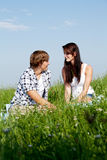 Young couple outdoor in summer on blanket Royalty Free Stock Image