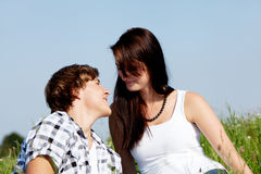 Young couple outdoor in summer on blanket Royalty Free Stock Photo