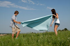 Young couple outdoor in summer on blanket Stock Photo