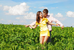 Young couple outdoors. Playing on a spring meadow Stock Image
