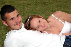 Young couple outdoors. A happy young couple lying in the grass Stock Images