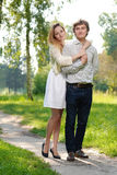Young couple outdoors. Young happy couple walking around outdoors Stock Photography