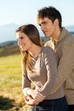 Young couple outdoors in rural field. Royalty Free Stock Images