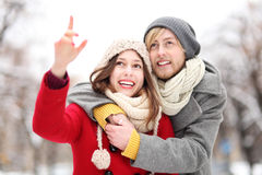 Young couple outdoors, woman pointing Stock Photography