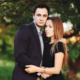 Young  couple outside bonding. Looking at camera, summer portrait Royalty Free Stock Photo