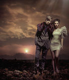 Young couple over sunset background Royalty Free Stock Photo