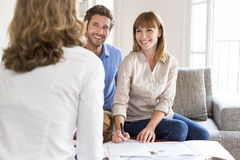 Young couple owners meeting real estate agent for house investment Stock Photo