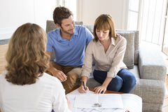 Young couple of owners meeting real estate agent for house investment Stock Photo