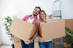 Young couple packing boxes for moving. To a new home Royalty Free Stock Image