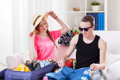 Young couple packing luggage Royalty Free Stock Photo