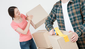 Young couple packing their things in cardboard boxes Stock Image