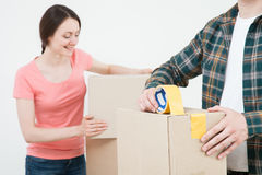 Young couple packing their things in cardboard boxes Royalty Free Stock Image