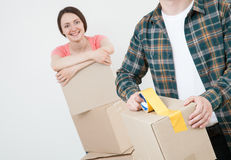Young couple packing their things in cardboard boxes Stock Images