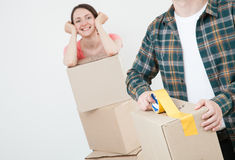 Young couple packing their things in cardboard boxes Stock Photography