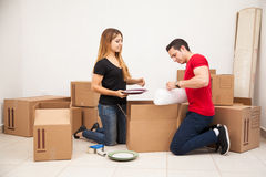 Young couple packing their things Stock Photo