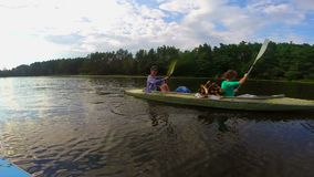 Young couple paddling kayak, active rest, tourism. Slow motion. Stock footage stock video footage