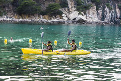 Young couple paddling in kayak Royalty Free Stock Photos