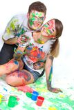 Young couple painting over white. Young happy couple painting over white Stock Photos