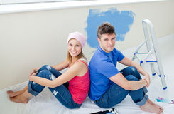Young couple painting a room during s break Stock Image