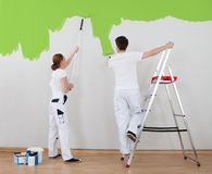 Young couple painting wall Royalty Free Stock Photography