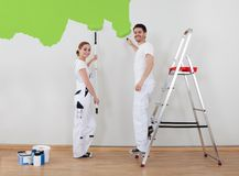 Young couple painting wall Stock Image