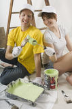 Young couple painting a wall together Stock Images