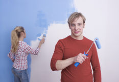 Young couple painting walls Royalty Free Stock Image