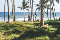 Young couple among palms on the tropical island of Bali. Indonesia Stock Photos
