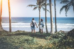 Young couple among palms on the tropical island of Bali. Indonesia Royalty Free Stock Photos