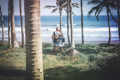Young couple among palms on the tropical island of Bali. Indonesia Royalty Free Stock Image