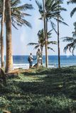 Young couple among palms on the tropical island of Bali. Indonesia Royalty Free Stock Photography