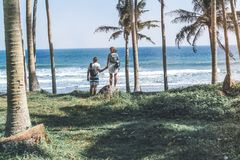 Young couple among palms on the tropical island of Bali. Indonesia Stock Images