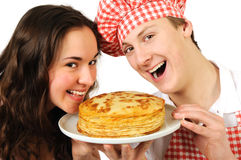 Young couple with pancakes Stock Photography