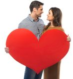 Young couple with paper heart Royalty Free Stock Photo